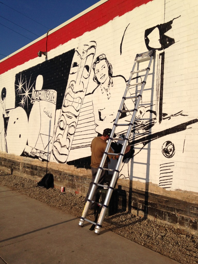 Mural in process with Jonas Never working on it  Mar Vista Mural by Jonas Never